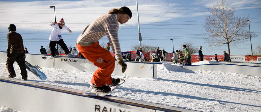 Photo of snowboarders riding the rails at the Ruby Hill Rail Yard