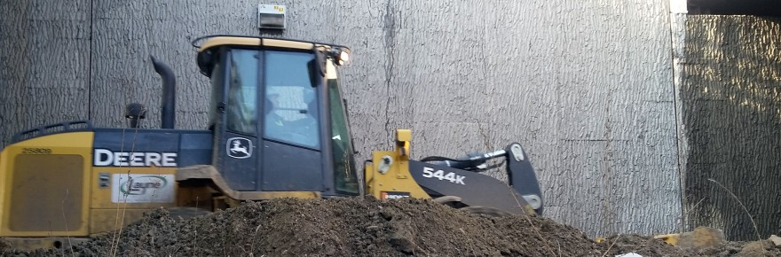 A bulldozer pushes dirt during the full closure of Mississippi Avenue.