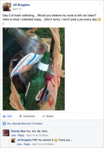 A screenshot of a Facebook post in which a neighbor posts a photo of a bag of trash they collected.