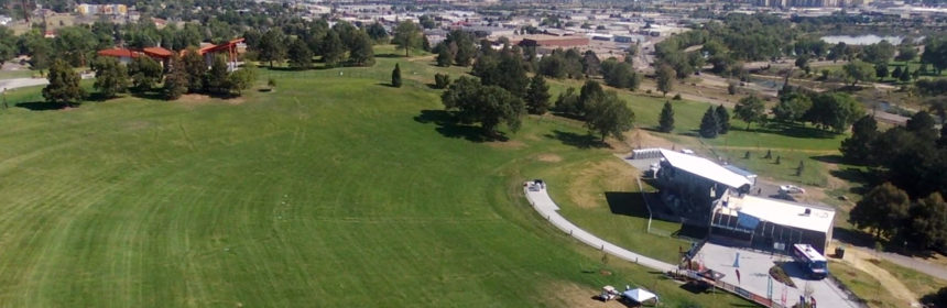 An aerial photograph of a portion of the Ruby Hill Park showing Levitt Pavilion and the Denver skyline.