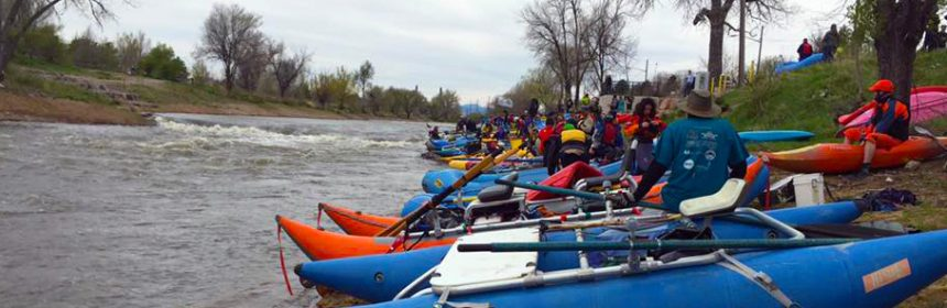 Kayaks and rafts staged near Ruby Hill Park before taking off down river to collect trash during the annual Platte River Clean-Up.